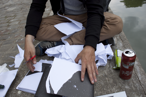 Cutting posters on the Canal Saint-Martin, Paris